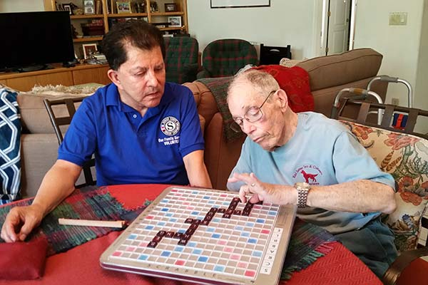Two Men playing scrabble